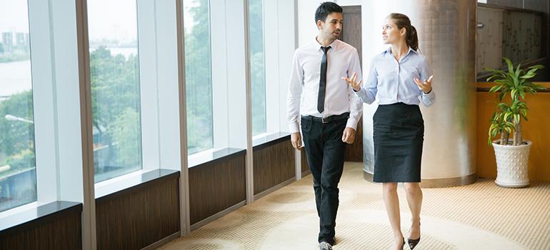 Business People Walking in Office